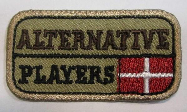 """Applikation """"Alternative Players"""" beige 55 x 30 mm"""